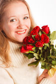 Woman with the bouquet of red roses — Stock Photo