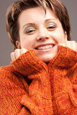 Woman in the sweater of orange color — Стоковое фото
