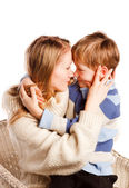 Woman with a son on a white background — Stock Photo