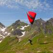 Paragliding in swiss alps - Stock Photo