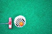 Mini golf and green background — Stock Photo