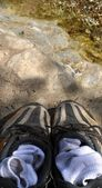 Shoes and socks on the bank — Stock Photo