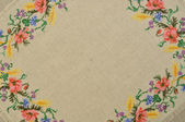 Linen canvas background with embroidery — Stock Photo