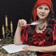 Charming lady writing a letter — Stockfoto