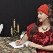Stock Photo: Charming lady writing a letter