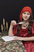 Charming lady writing a letter — Stock Photo