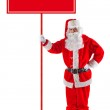 Standing Santa Claus with a sign — Stock Photo