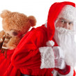 Half-length portrait of Santa Claus with a bag of gifts — Stock Photo