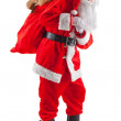 Standing Santa with a bag of gifts — Stock Photo