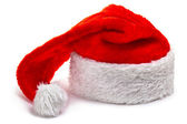Santa Claus hat, lying on a white — Stock Photo