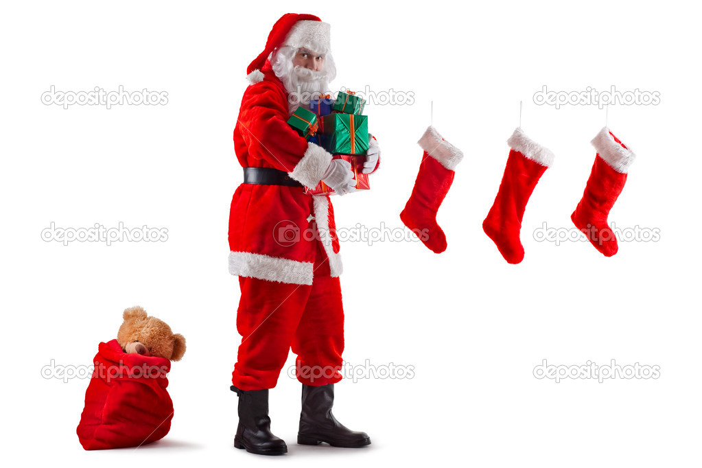 Santa Claus is ready to distribute gifts. Isolated on white.  Stock Photo #4505756