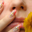 Female face close and nail art — Stock Photo #3940078