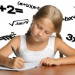 The girl and mathematical formulas - Stock Photo