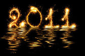 2011 made of sparks in water — Stock Photo