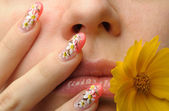 Female face close and nail art — Stock Photo