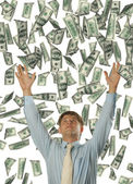 The young businessman falling dollars — Stock Photo