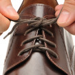 To fasten bootlace on shoes — Stock Photo