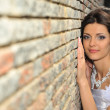 The bride at a wall - Stock Photo