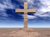 Stone cross on the cracked ground — Stockfoto