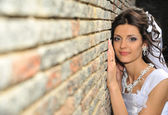 The bride at a wall — Stock Photo