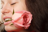 The woman with a rose closeup — Stock Photo