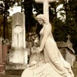 Stock Photo: Tombstone women with cross