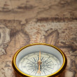 Old compass on ancient map — Stock Photo