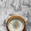 Old compass on ancient map — Stock Photo #5198683
