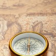 Old compass on ancient map — Stock Photo #5198694