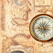 Old compass on ancient map — Stock Photo #5198697