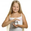 The girl holds an alarm clock in hands — Stock Photo #5198760