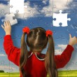 Girl assemble big puzzle — Stock Photo #5198818