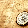 Compass on old map. — Foto de Stock