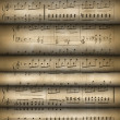 Roll old musical notes — Stock Photo #5199087