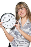 The business woman with clock in hands — Stock Photo