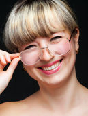 Portrait of the woman in eyeglasses close up — Stock Photo