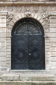 Iron doors, input in a building — Stock Photo
