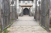 Input and suspension bridge in old castle — Stock Photo