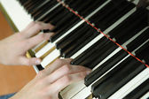 Hands above keys of the piano — Stock Photo