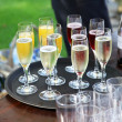 Many of champagne and orange juice - the glasses on a Tablet — Stock fotografie