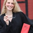 Friendly smiling law student or lawyer with red law book under h — Stock Photo #4224998