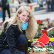 Woman buying flowers on the market — Stock Photo #4476814
