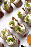 Sweet dessert decorated with kiwi — Stock Photo