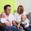 Young families with babies - twins at home — Stock Photo