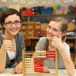 Teacher and a student show at school thumbs up — Stock Photo