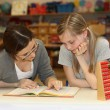 Stock Photo: Teacher and student in school textbook learning together