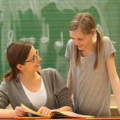 Teacher and student in education at schoo — Stock Photo