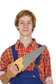 Carpenter with handsaw — Photo