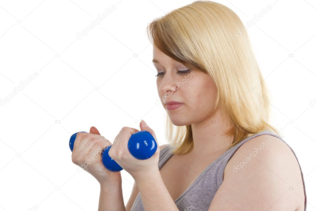 Young woman with dumbbell - isolated on white — Stock Photo #4991404