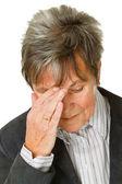 Senior woman with headache — Stock Photo